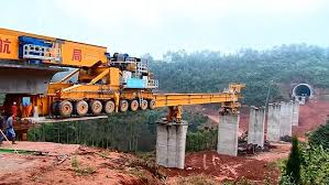Watch how this mega machine constructs a bridge in mountains.